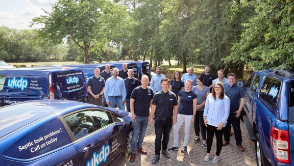 UKDP team of drainage experts outside offices with vehicle fleet