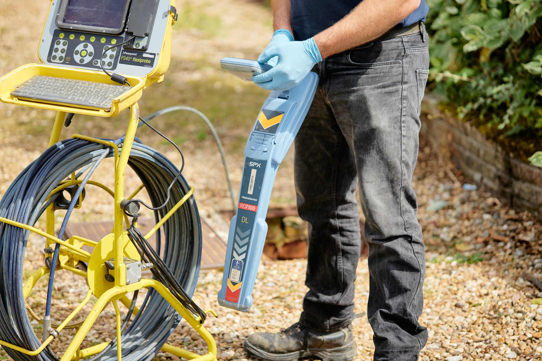 UKDP team with drainage surveying equipment